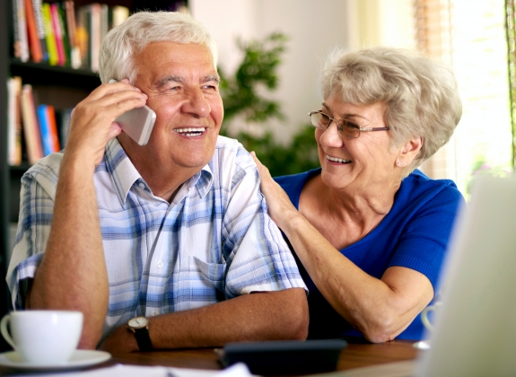 a retired couple on the phone booking rail travel