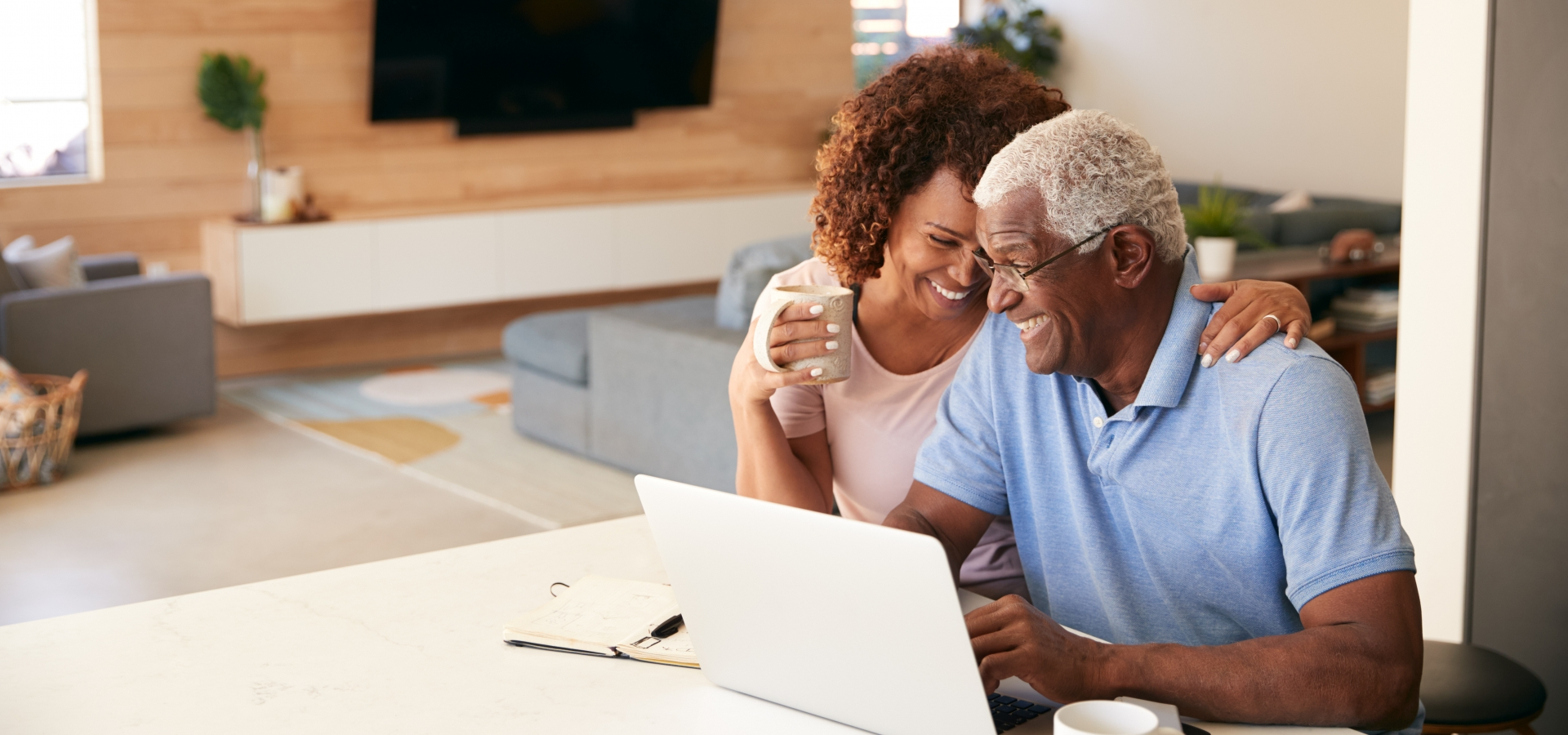 retired couple looking at train vacations on their computer