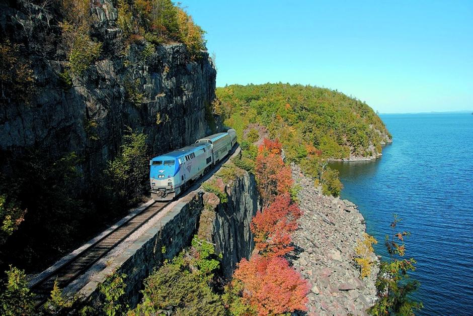 Amtrak train through fall foliage